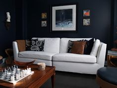Finally, we are in the last stages of the living room. not that any room is ever really finished, is it? Finished is an awfully strong word. Black Leather Sofa Living Room, Black Leather Sofas, Dark Walls, Blue Walls, Home Libraries, House Built, Wainscoting, Living Room Designs, Living Rooms