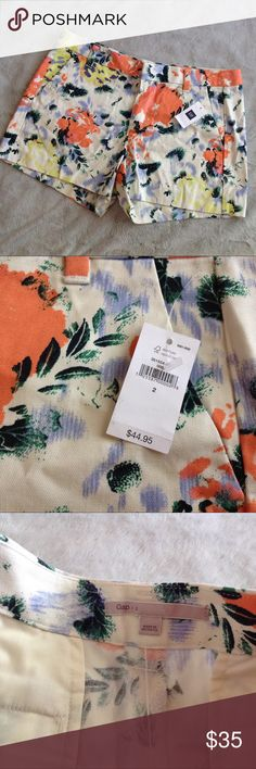 NWT Gap Cotton Floral Print Shorts Brand new, never worn.  100% cotton shorts by Gap. White with abstract floral pattern in coral, blue, green and yellow allover. Side pockets and flat back pockets. Belt loops. Size 2, see photos for measurements. GAP Shorts