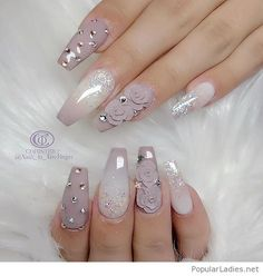 Long grey gel nails with applications