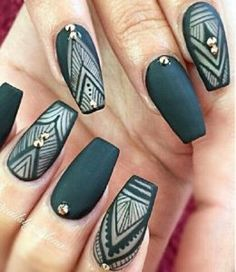 Matte Green with Nude colors. The patterned green and white with the single or couple of gold stud at the bottom of the nails is the true inspiration for all the pattern lovers.
