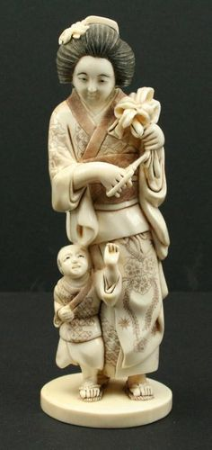 """JAPANESE CARVED IVORY OKIMONO MOTHER & CHILD Well executed okimono carving of a mother and child. Signed. Size: 6"""""""