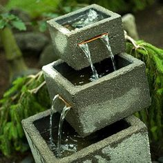 Water, in Japanese gardens, can either be real or imagined. Fountains, like this tiered stone one in this garden, can enhance the feeling of calm through the sound of water.