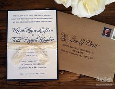 Blue and white with tan envelope.  Rustic Navy Wedding Invitation Kraft & Lace. $4.00, via Etsy.