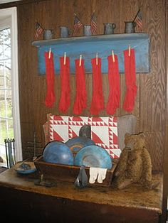 neat contrast in the blue/red, love the little pewter pieces on the shelf with primitive flags