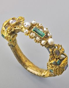 SPANISH SHIPWRECK SALVAGE GOLD EMERALD BRACELET; Revised or assembled hinged gold bracelet rebuilt of gold (various alloys), emeralds, and foil-backed diamonds with pearls, lead solder apparent. Parts found off the coast of Florida. 16th-19th c. #antique #SpanishShipwreck #bracelet