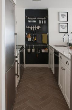 This kitchen had a small alcove at the end of the appliance run. They made it a feature by painting it with blackboard paint and then adding ikea shelves. Could do the same even without an alcove