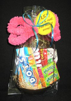 Lei Back & Rest    A unique tropical gift to give to someone who isn't feeling so well.  2 plastic coconut shells filled with tropical candy tied with a lei with a tag that reads:  Lei back and rest:  feel better soon!
