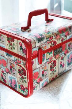 Decoupage a piece of luggage...how cute is this...