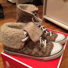 Coach shearling sneaker converse style So fun and great for the fall and winter style. Lightly worn. Bottom white stipe area has signs of wear but can be cleaned easily with sneaker cleaner. Pictured in photos.  Size 10 Coach Shoes Sneakers
