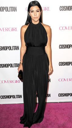 Kourtney Kardashian in a black halter jumpsuit