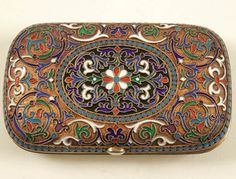 RUSSIAN SILVER-GILT AND CLOISONNE ENAMELED CIGARETTE CASE overall enameled with strapwork and scrolling foliage on a gilt stippled ground, with double beaded border.