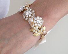 Ribbon Bracelet, Gold Bridal Bracelet, Swarovski Crystal Rhinestone Wedding Bracelet, Gold Wedding Jewelry, Ivory Pearl, Bow MIER RIBBON. $90.00, via Etsy.