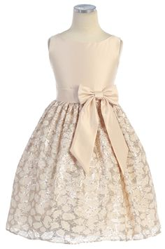 I thought it was a shade of pink, but it's gold. $80 (Whoa!) No sizes for Baby. Love the skirt.