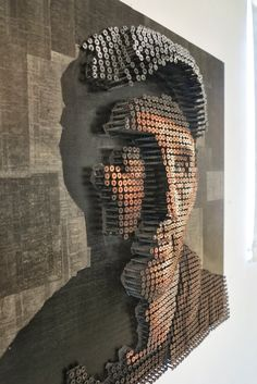 With the help of thousands of screws, Andrew Myres, a 31-year-old artist from Orange County, California, manages to mind-blowing portraits.  Read more: http://freshome.com/2011/02/28/drilling-thousands-of-screws-for-unusual-3d-mural-portraits/#ixzz3Ot36NKG4  Follow us: @freshome on Twitter | freshome on Facebook