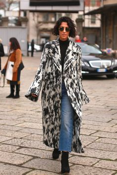 Yasmin Sewell, a fashion director, wore a bell-sleeved coat on the first day of Milan Fashion Week. (Photo: Craig Arend for The New York Times)
