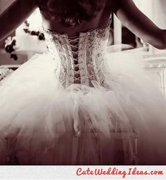 Corset-style wedding dress. The perfect touch without being completely backless.