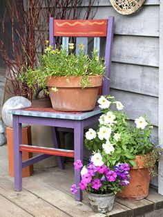 Reuse an old chair Another example of Jill's and Tom's recycling: A coat of paint turns an old chair into a colorful perch for a flower container.