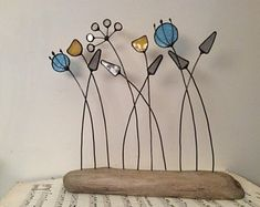 Stained Glass and Wire Flowers on Driftwood