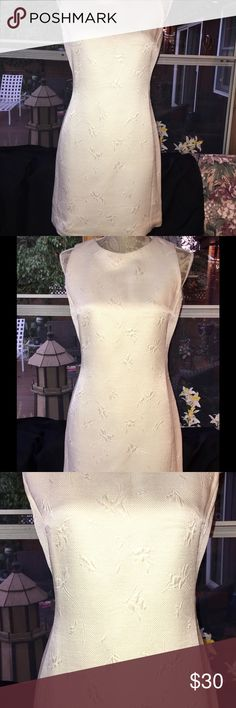 LOUIS FERAUD OFF WHITE SHEATH DRESS SIZE 4 BEAUTIFUL LOUIS FERAUD WOMEN'S OFF WHITE/IVORY SLEEVELESS SHEATH DRESS WITH PRETTY DESIGN SIZE 4. GENTLY WORN, HAS 1 SMALL STAIN THAT I WAS UNABLE TO GET OUT SHOWN IN PICTURE, GOOD CONDITION. Dresses