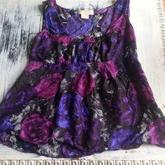 Michael Michael Kors Black w Purple & Blue Floral Michael Michael Kors Black w Purple & Blue Floral Tank Top. Size 6.. 100% silk. Zips on side. Open to offers! MICHAEL Michael Kors Tops Tank Tops