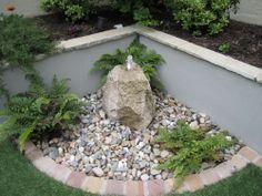 An elegant water feature in a small garden design in Stillorgan, County Dublin, Ireland