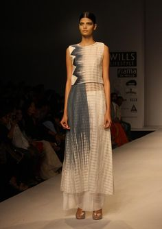 White on white, with splashes of woven blue by Vaishali S