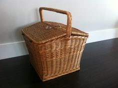 This Vintage Rattan Wicker Picnic Basket measures 12 inches high (17 inches with handle), 15 inches wide, and 15 1/2 inches deep. It has a double side