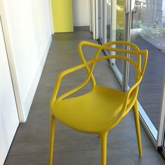 Kartell Masters chair in mustard.