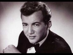"Bobby Darrin, ""Mack the Knife."" [T]he standard from Kurt Weill's Threepenny Opera, was given a vamping jazz-pop interpretation. Although initially opposed to releasing it as a single, the song went to No. 1 on the charts for nine weeks, sold two million copies, and won the Grammy Award for Record of the Year in 1960."" [Wikipedia]"