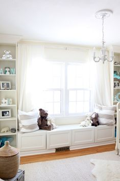 White, gender neutral nursery - we love the layered rugs and varying textures in this sweet room!