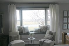Drapes For Living Room Bay Short Curtains For Kitchen Curtains For Living Room . Simple Scarf Swag Over Bay Window Or Bow Window Allows . Basement Window Curtains Living Room Traditional With . Home and Family Window Seat Curtains, Bay Window Decor, Bay Window Living Room, Window Seat Cushions, Window Benches, Bedroom Windows, Bay Windows, Blinds Curtains, Hang Curtains