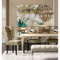 Dramatic and decadent, golden accents add a glamorous touch. Dress up your dining room with lustrous gold. The glimmer and shimmer of gorgeous gold trim outlining a chic mirrored dining table or splashed across impressive abstract wall art brings eye-catching appeal and rich warmth to this formal space. Bold metallic accents make a brilliant impact even in small doses and instantly elevate the status of any room.