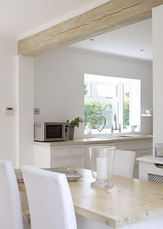 Perfect example of how the smallest amount of pale, blond wood can add interest and texture to an otherwise flat and modern extension