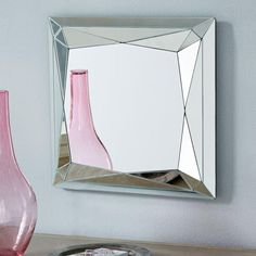 This deco-inspired mirror's faceted border reflects more light than a typical mirror. It's perfect for creating the illusion of extra space in smaller rooms, corners and hallways.