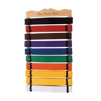 Rank Belt Displays Natural 10 Level: Display your belts with pride and style with these classy solid wood belt displays that feature elastic straps that hold six or 10 belts securely on inch slats. Belts shown not included. 10 Level Size: Inch x 14 Inch.