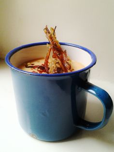 Parsnip coconut soup with chili flakes, ginger flavor and caramelized and flambeed parsnip sticks.