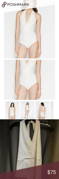 🌟NWOT Halston Heritage White Bianca Bodysuit 🌟 HALSTON HERITAGE bodysuit features an iconic halter V-neckline with adjustable ties and a slim fit in an allover fine rib knit. A key layering piece that styles perfectly with skirts and pants for that effortlessly tucked-in look.  Tie closure at back neck. 45% Viscose 43% Nylon 12% Spandex Unlined Hand wash separately, lay flat to dry, or dry clean. U.S. made LGR070233 Model is wearing a size S and is 5 ft 10 in. Halston Heritage Other