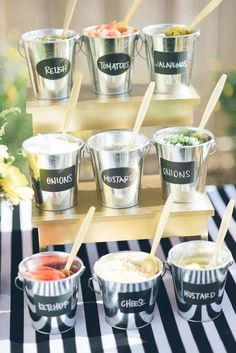 Toppings Bar ideas for tacos, nachos, hot-dogs, hamburgers and more. | Easy, inexpensive and simple decorations and buffet table display for your next Superbowl Football party. |