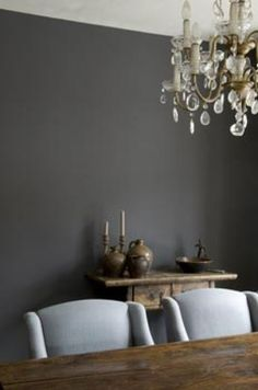 A warm, dark, smoky grey. Not actually black. Carol, I'm just playing with ideas.  Notice how the natural rustic wood works with this color
