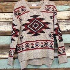 Check out this cute sweater! Buy it now at www.thespottedzebrastore.com