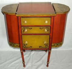 ANTIQUE HAND PAINTED WOOD SEWING CABINET, C H W D gold accents and vine designs, 3 drawers vertically in front with one on each side accessed through the hinged top compartment doors of half circle design. Distressed Furniture, Antique Furniture, Painted Wood, Hand Painted, Country Cottage Bedroom, Sewing Cabinet, Vine Design, Cozy Bedroom, Drawers