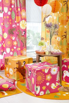 Vallila & Mimmit collection: Kevätlaulu, orange & pink curtain, cushion and rug. Design Meri Mort & Vallila Design Studio