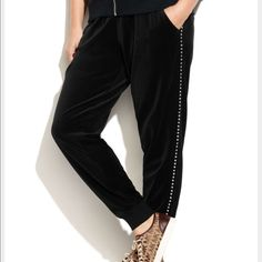 Michael kors studded jogger pants Go comfortably chic with Michael Michael Kors' plus size velour jogger pants, embellished with upscale tuxedo-stripes of glittery rhinestones down the legs. Michael Kors Pants Track Pants & Joggers