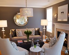 Dark gray walls, light gray couch, bright accents