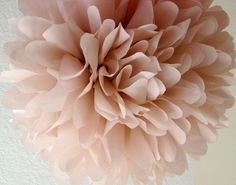 We love the idea of a reception hall filled with pompoms. Dusty Pink 1 tissue paper pom by PomLove. $4.50.