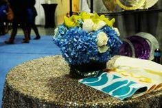 When it comes to linens, sequins are hot—BBJ Table Fashions showcased its new matte mercury sequin overlay, also available as a table runner. Also on display were fabric samples of the company's new reversible Miramar linens and napkins, which come in six different colors.