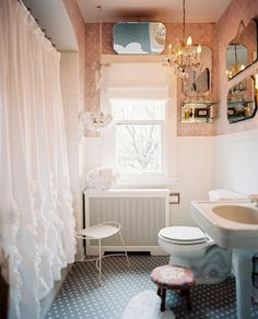 Bathroom Photo - A ruffled shower curtain and pink wallpaper in a bathroom