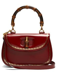 A modern interpretation of the house s 1947 iconic style, this Gucci bamboo-handle  leather ff8c595bf96
