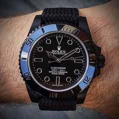 All black Rolex Submariner on matching perlon strap⚫️ this is one of my favorite rolexes. Would you wear this? What do you think? Tag a Rolex Lover! What's your ideal wrist game? -------- Watch Strap via @whatchsdotcom Watch Custom made by @EmberWatches!