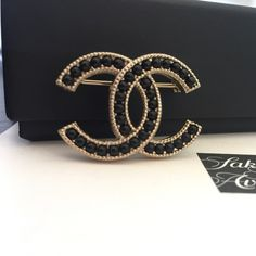 """CHANEL Molten Lava Glass Gold Brooch Beautiful classic CC brooch from pre-fall 2016. Unique poured molted lava glass crystal hand set upon lightened filigree gold.  New with full set & receipt from Saks.  1.25"""" wide x .75"""" tall. CHANEL Jewelry Brooches"""